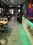imagen de Interior del Restaurante La Mafia se sienta a la mesa en Cáceres.