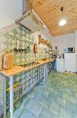 imagen de Cocina con mobiliario que permite acercamiento frontal en silla de ruedas, apartamento waschkuche. Información recopilada de www.altes-waschhaus-dresden.de