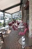 imagen de Terraza con mesas en Hotel Iriguibel
