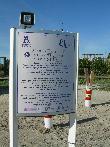 imagen de Panel informativo sobre servicio de audio playa de Talamanca. Ibiza