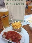 imagen de Curry Wurst con cerveza